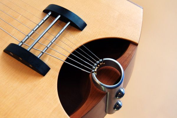 Rick Toone acoustic guitar bridge. Very original idea!