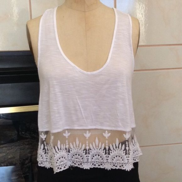 LF lace trim tank LF Emma&Sam White lace trimmed tank top. Only worn once, so like NWOT condition.Lower offsite. LF Tops Tank Tops