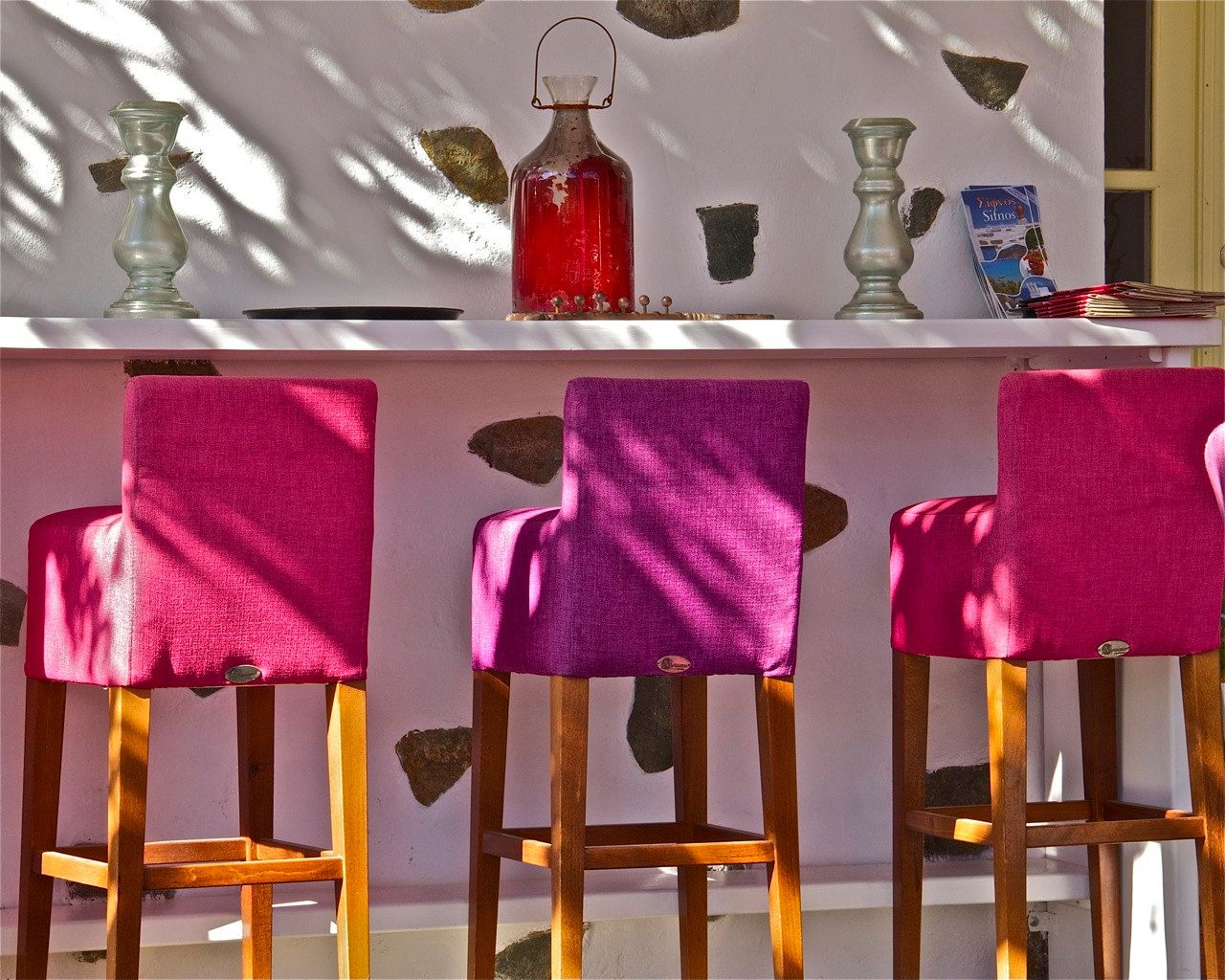 pink fuschia hot pink white Chairs photograph Greece vibrant shadows bar stools via