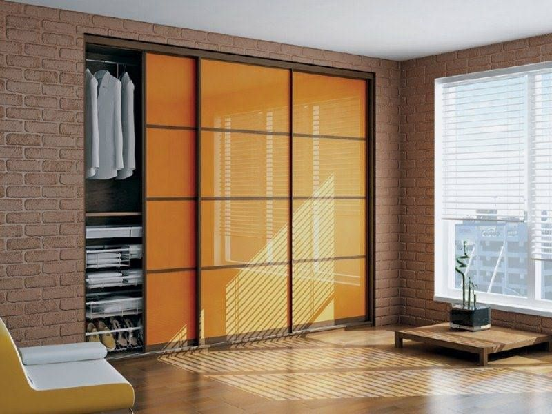 Orange Glass Sliding Doors For Bedroom Closet A Nice Way To Highlight A Modern Closet Space Cupboard Design Wardrobe Design Sliding Wardrobe Designs