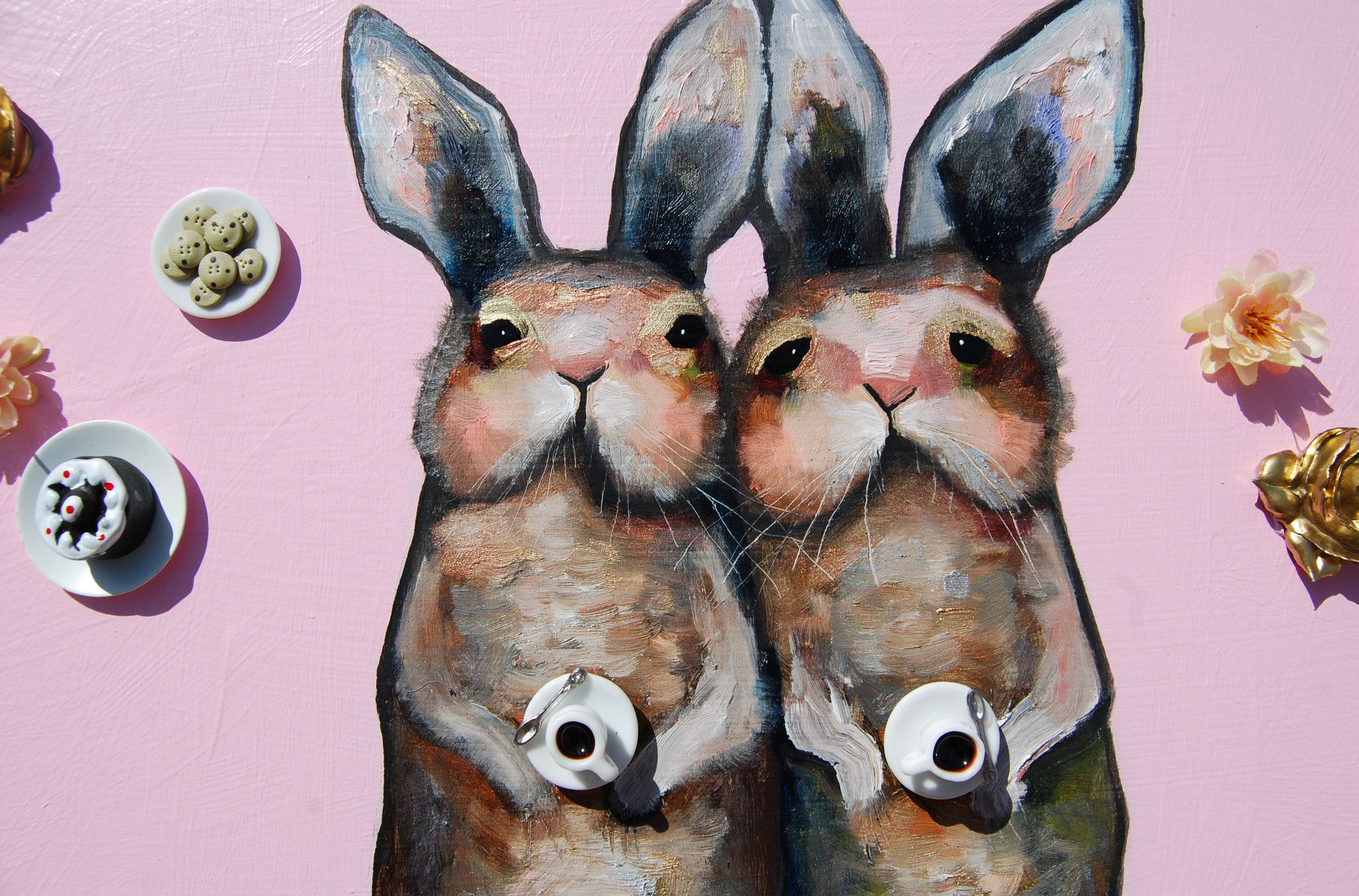 """2014 36"""" x 9.75"""" Oil, acrylic and found objects.Two bunnies meeting for coffee and cakes with thick oil paint and dollhouse miniatures."""