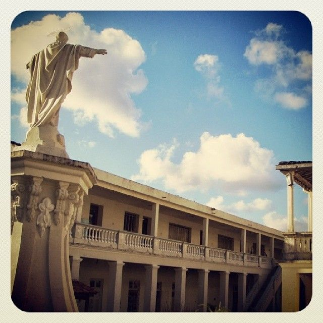 Embracing clouds... #college #spaces #gardens #statues #clouds #areas #catholic #constructions