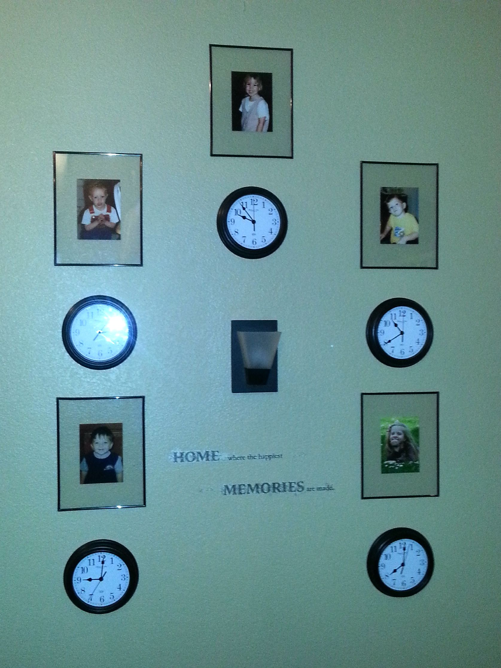 Commemorate the times your kids were born by combining clocks set to their special time with their pictures...can be adjusted to any space. So cute!!!