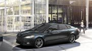 The 2014 Fusion Titanium in Dark Side Metallic with the optional 19-inch dark stainless H-spoke wheels.