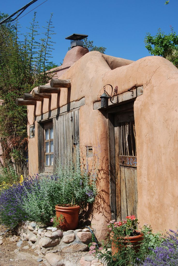 Flowers Adobe Wall And Weathered Door Santa Fe New