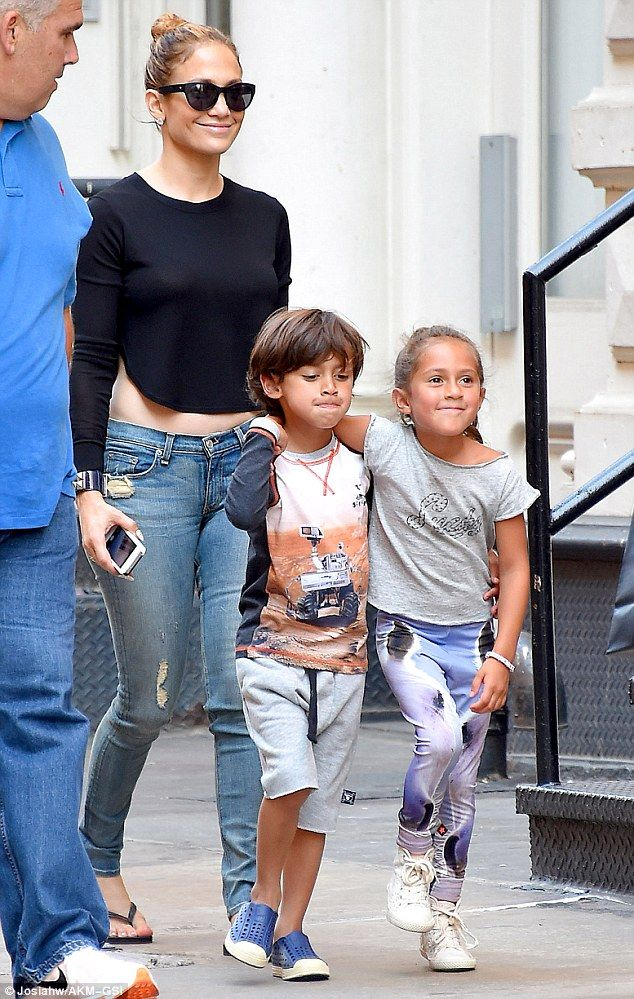 Proud mother  Jennifer Lopez flashed a grin as she took her twins Max and  Emme to get ice cream in New York on Monday..... Please tell me that Emme  looks ... d87228dbfd2dd