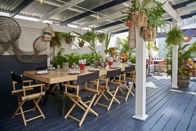 12 Restaurants And Bars With New Age Tropical Decor Beach House Decor Living Room Soho Grand Hotel Tropical Decor