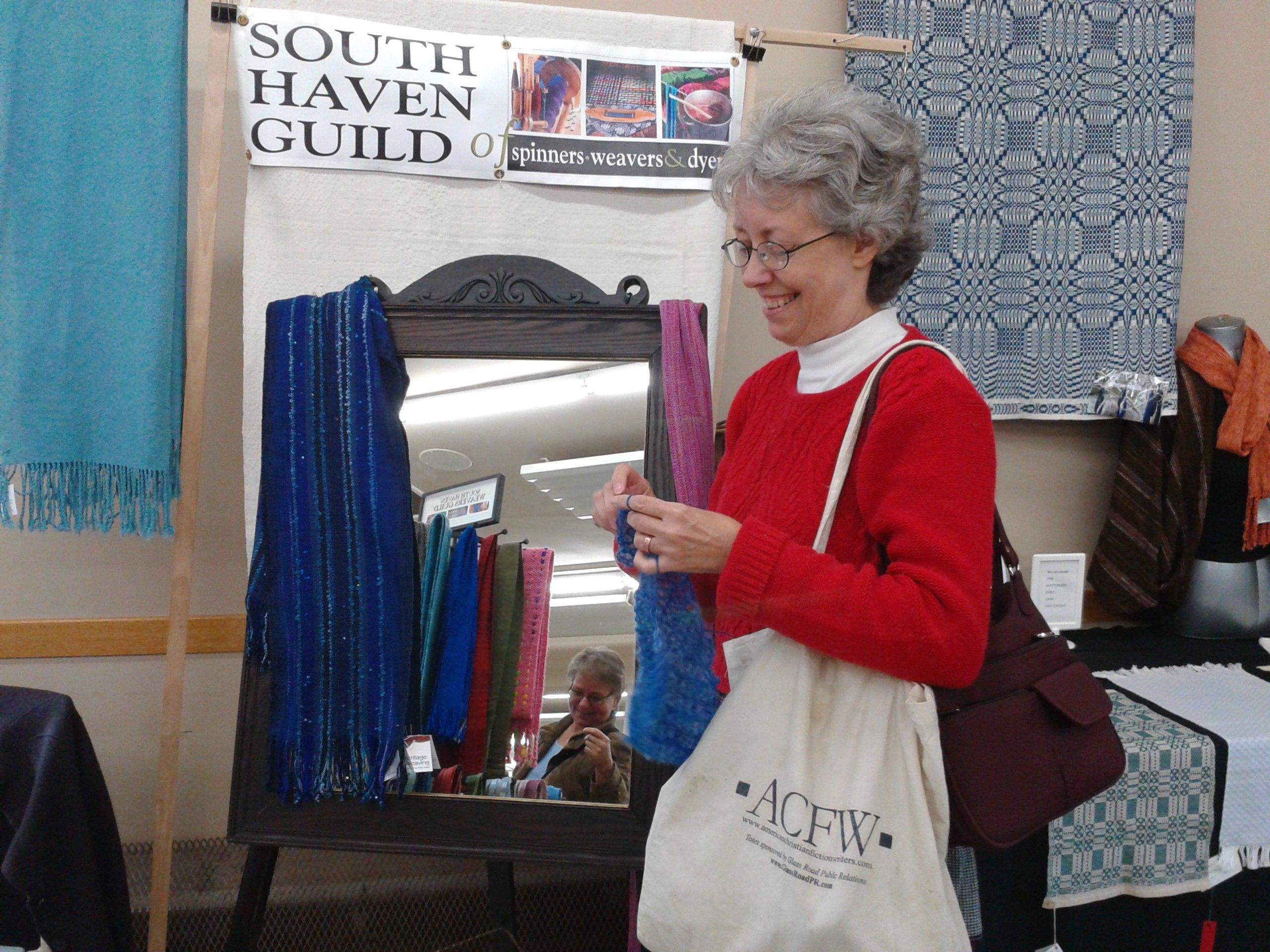 Me, myself, my crocheting, and my American Christian Fiction Writers tote, at the Fibre Festival in Baddeck during Celtic Colours week. If I carry the tote around, does that count as writing?