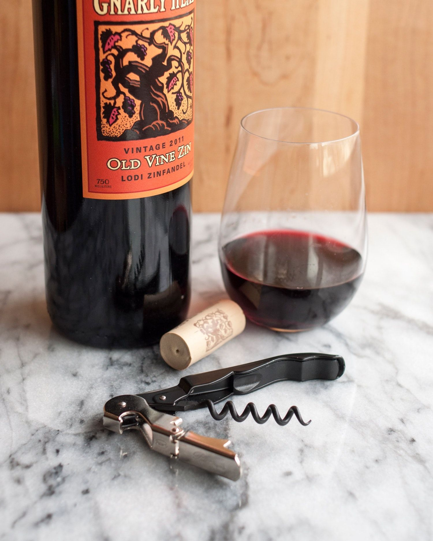 How to open a bottle of wine using a wine key corkscrew