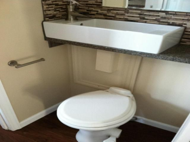 Small Spaces Tankless Toilet With Sink Above In Space Where The