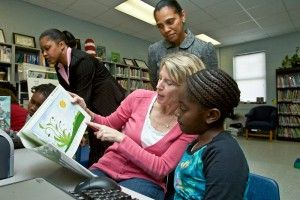 Carolyn reading to a preschooler in one of our early childhood learning centers in Summerton, South Carolina.