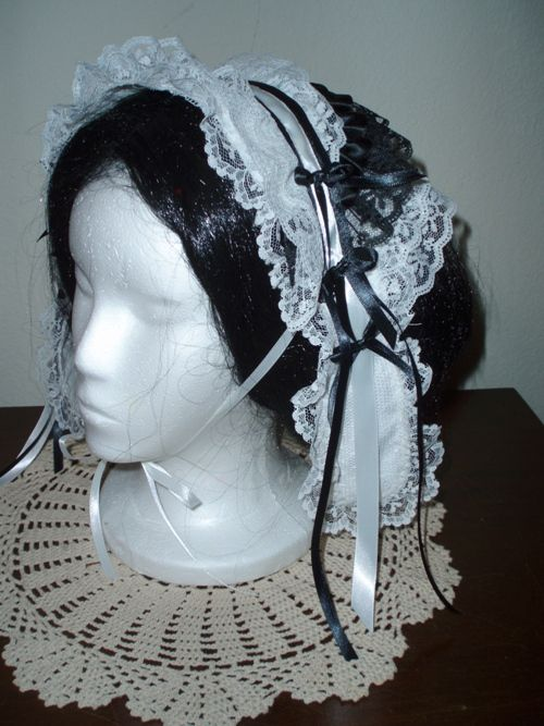 """During Victorian times, women covered their head during the day with day caps of lace, ribbons, and trim.  """""""