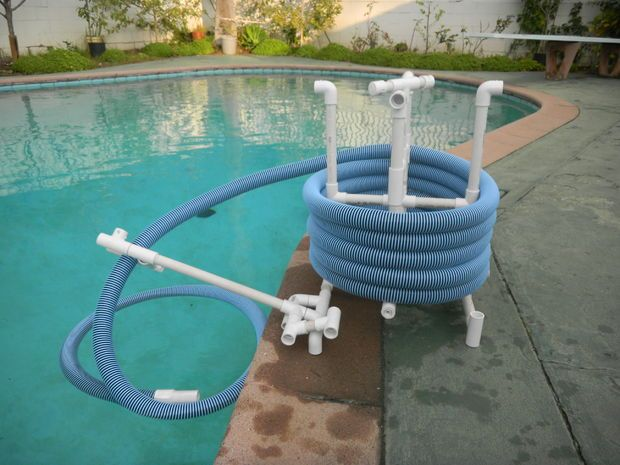 Pvc pool hose reel pvc pvc pool pool storage diy pool for Above ground pool storage ideas
