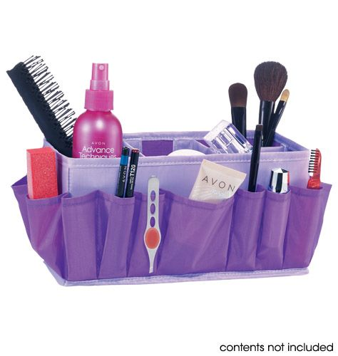 """Avon: Essential Beauty Holder - Holds brushes, mascaras, liners and more. With handy outside pockets for smaller items and removable inside dividers to keep everything in place. Folds for storage. 9 1/2"""" L x 5"""" H x 5"""" D (open). Polyester."""