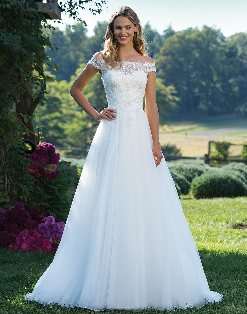 This portrait neckline illusion beaded lace and tulle ball gown ...