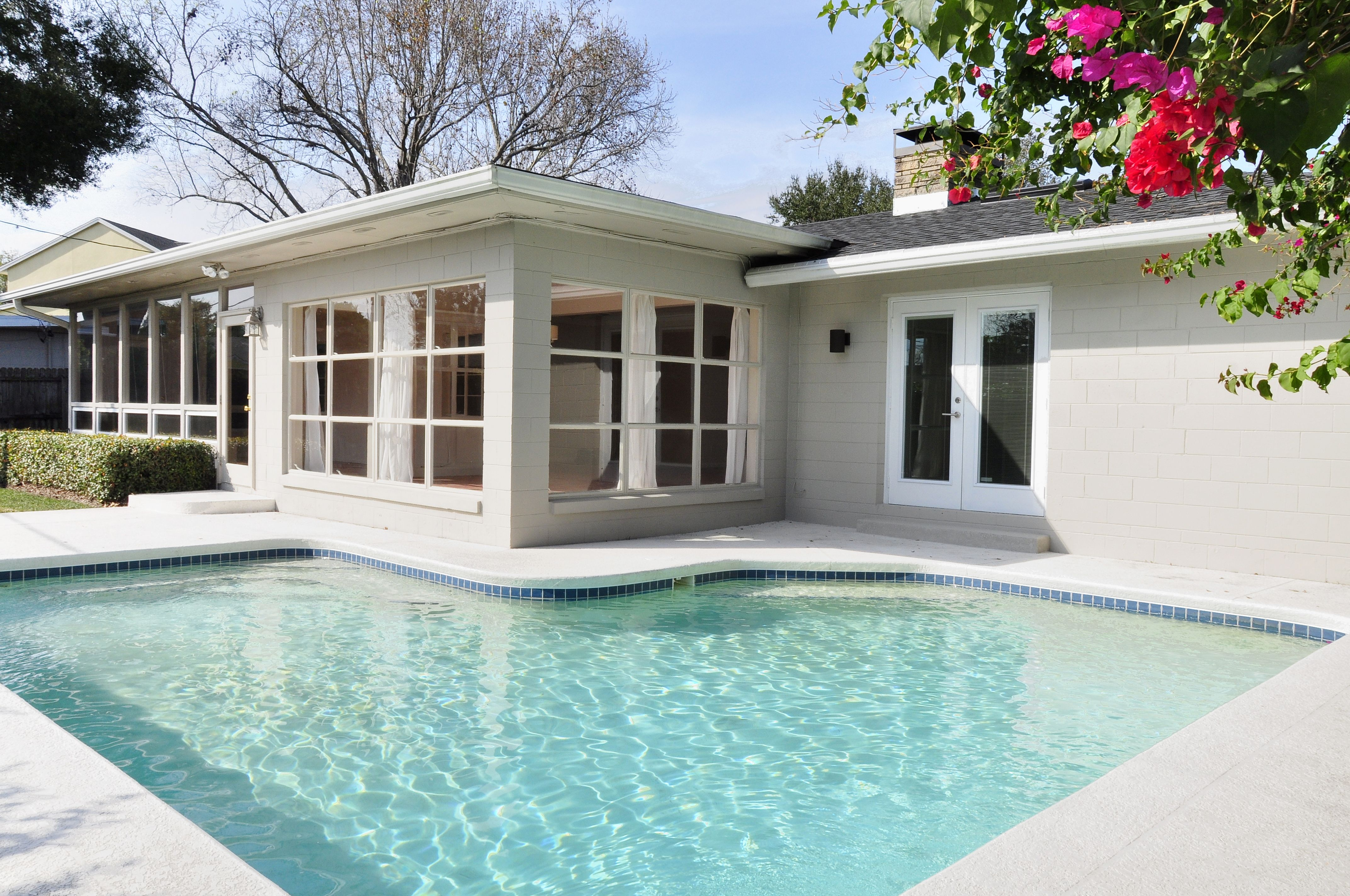 Enclosed Patio Sunroom With Big Windows Overlooking Custom Shape Pool By The Best Custom Home Builder Remodeler Patio Remodel Pool Patio Enclosed Patio