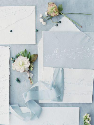 Sky blue wedding invitations with beautiful calligraphy: http://www.stylemepretty.com/2015/01/08/four-elements-wedding-inspiration/ | Photography: Ashley Bosnick - http://ashleybosnick.com/