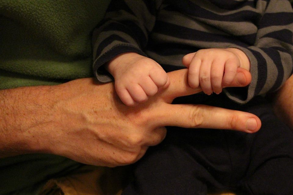 Monthly pic for 2 months - photograph dad's hands with # of fingers for month