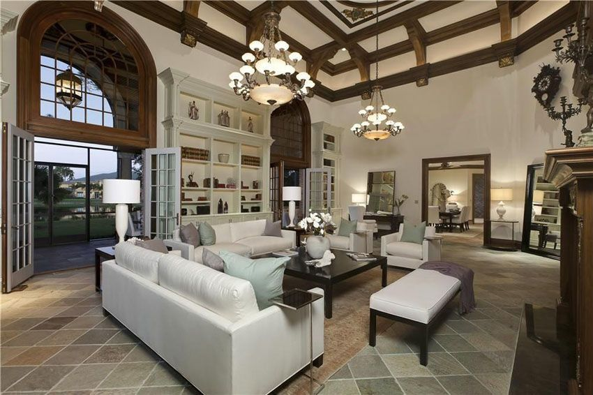 Traditional Living Room With Slate Floor Tiles And Dual Chandeliers