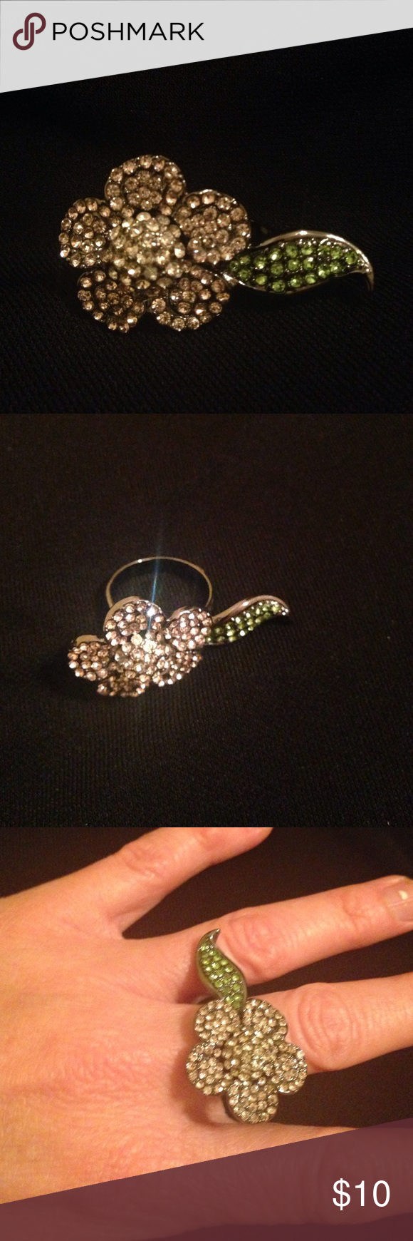 Guess pink sparkly flower 🌺 ring! Guess pink sparkly flower 🌺 ring with green leaf 🍃 that crosses over the other finger. Pink rhinestone petals and silver rhinestones inside of flower. Leaf has green rhinestones. Gunmetal colored band. Guess Jewelry Rings