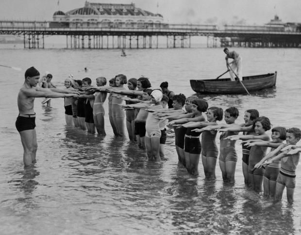 12 Vintage Photos Of People Learning To Swim The Way We
