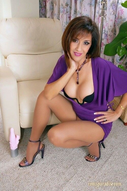 Sexy latina mom on a bed nude