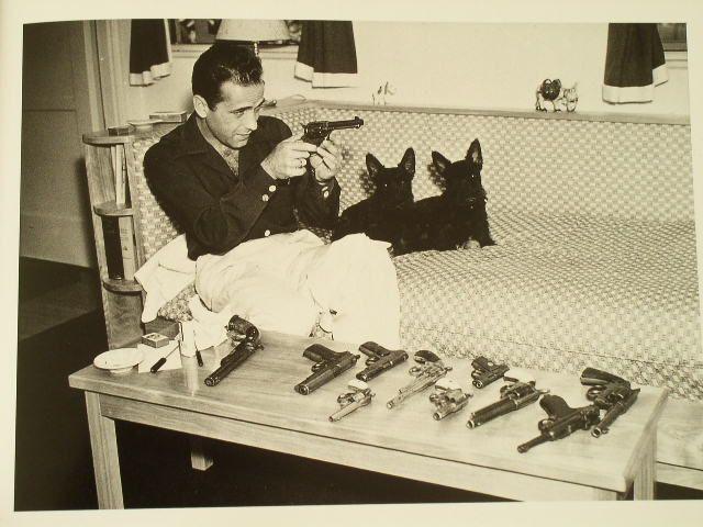 Humphrey Bogart loves guns, Scotties.