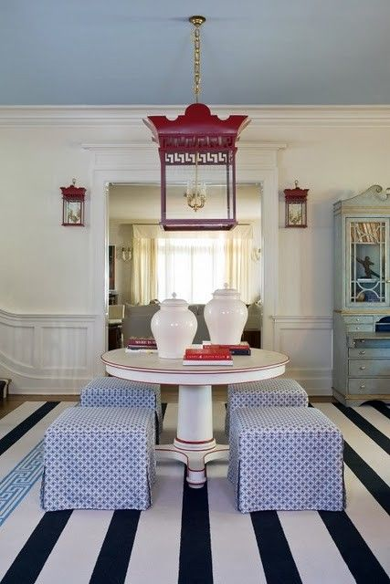 I love so many things.  Blue slate ceiling.  Table with trim.  Ottomans as chairs.  Rug.   Pagoda chandelier.  Chain holding pagoda chandelier.