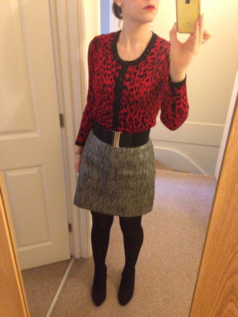 Red with black leopard print cardigan, silver and grey skirt ...