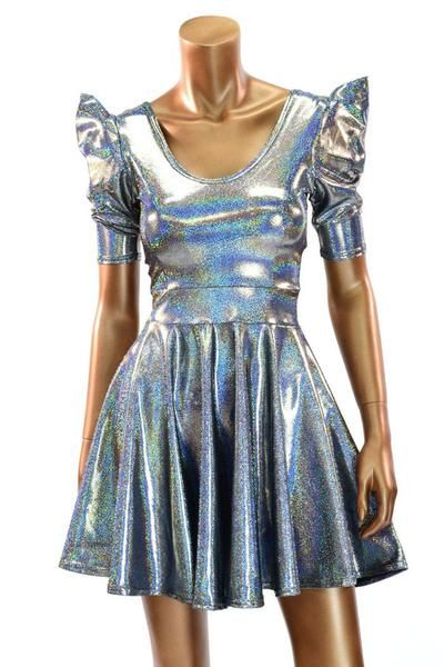 This stunning dress is made of four way stretch lycra spandex with a fantastic holographic sparkle.Tiny rainbows dance with every movement, on this dark silver