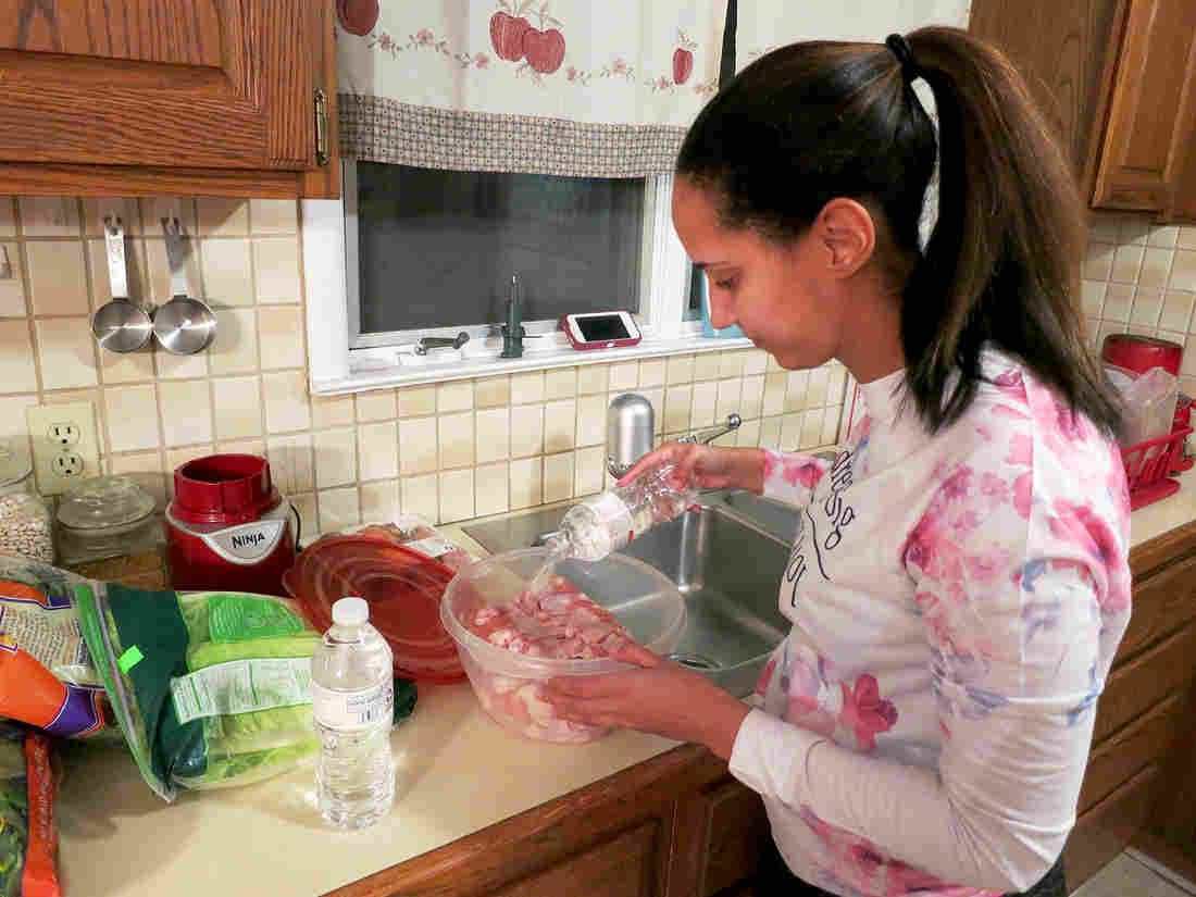 Ashara Manns says she has to plan her meals around how much bottled water she has.
