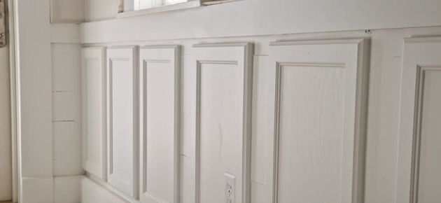 cabinet doors used for wainscotting.