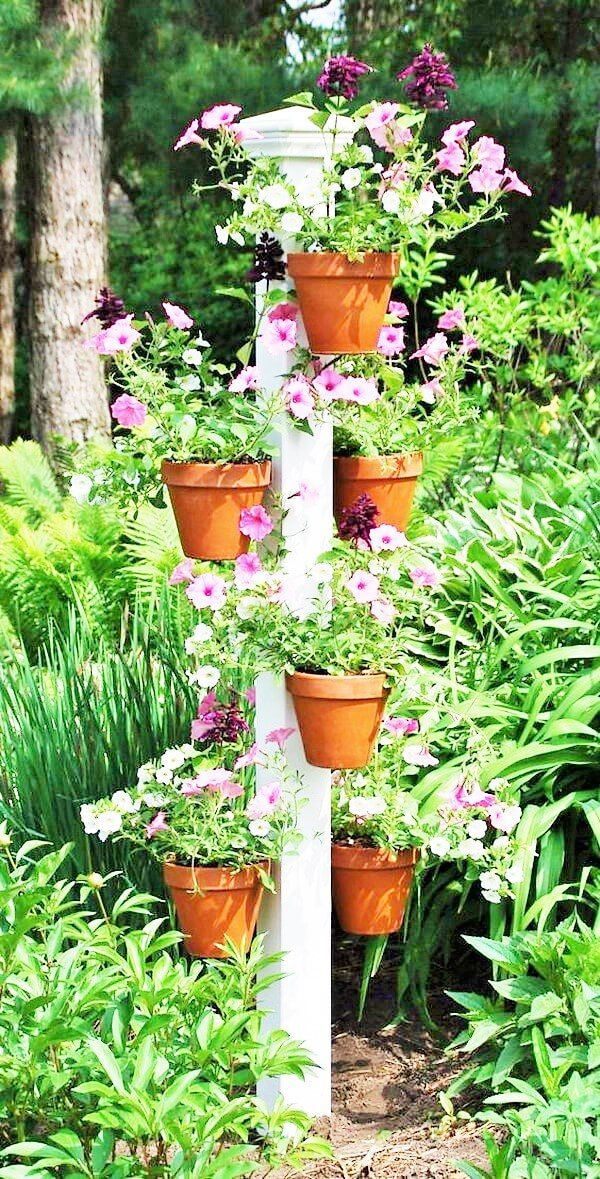 This Picture Also Has Some Plant Pots In It The Color Of The Plants Are Light Pink You Can See That The Whole Vertical Garden Flower Pole Herb Garden Design