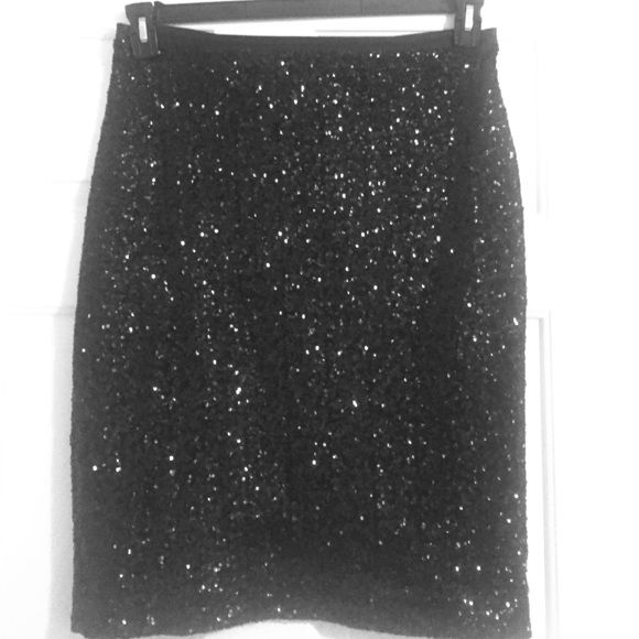 Express Sequin Knee Length Skirt Shiny sequin skirt with pleather detail at waist. Skirt runs a bit large and would also fit a size 14.  Skirt has slit in the back and is in good condition. 100% Polyester Express Skirts Pencil