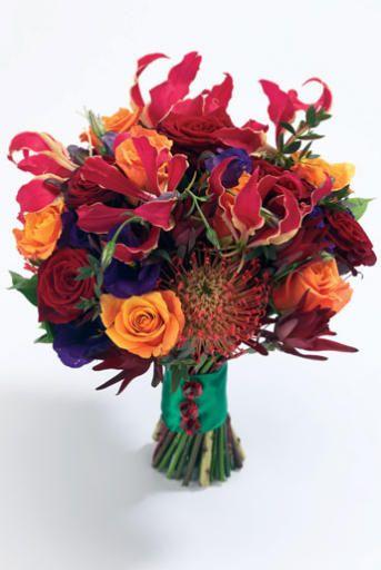 Gloriosa Lilies, Pincusion Protea, lisianthus, roses, Safari sunset