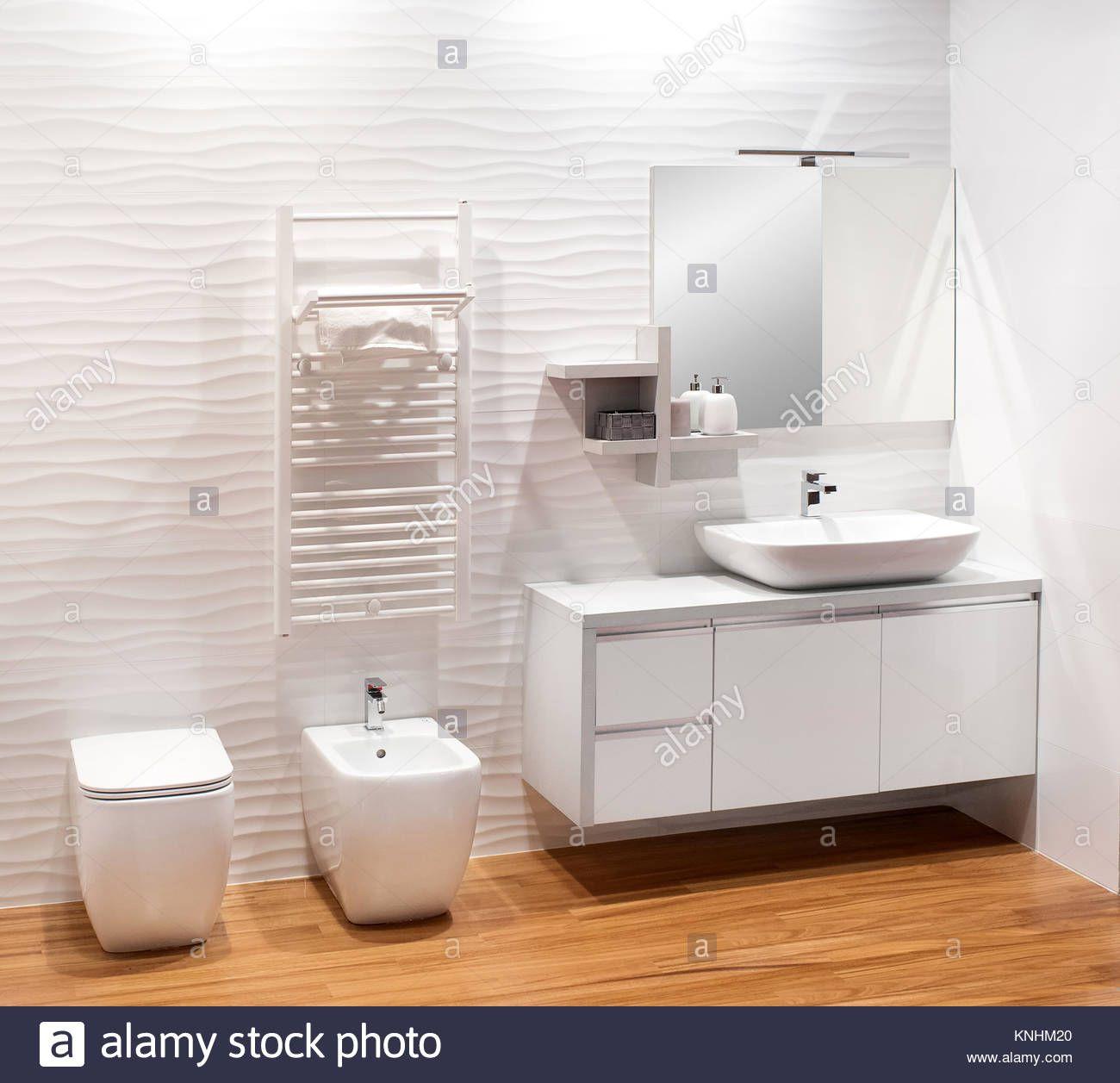 Download This Stock Image Plain Monochromatic White Bathroom With Simple Vanity Cabinet Bidet And Toilet O Small Bathroom Tiles Small Bathroom White Bathroom