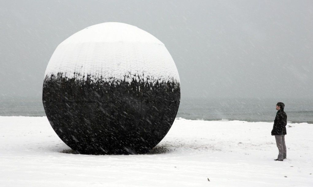 This giant wooden ball is a spherical lifeguard tower in