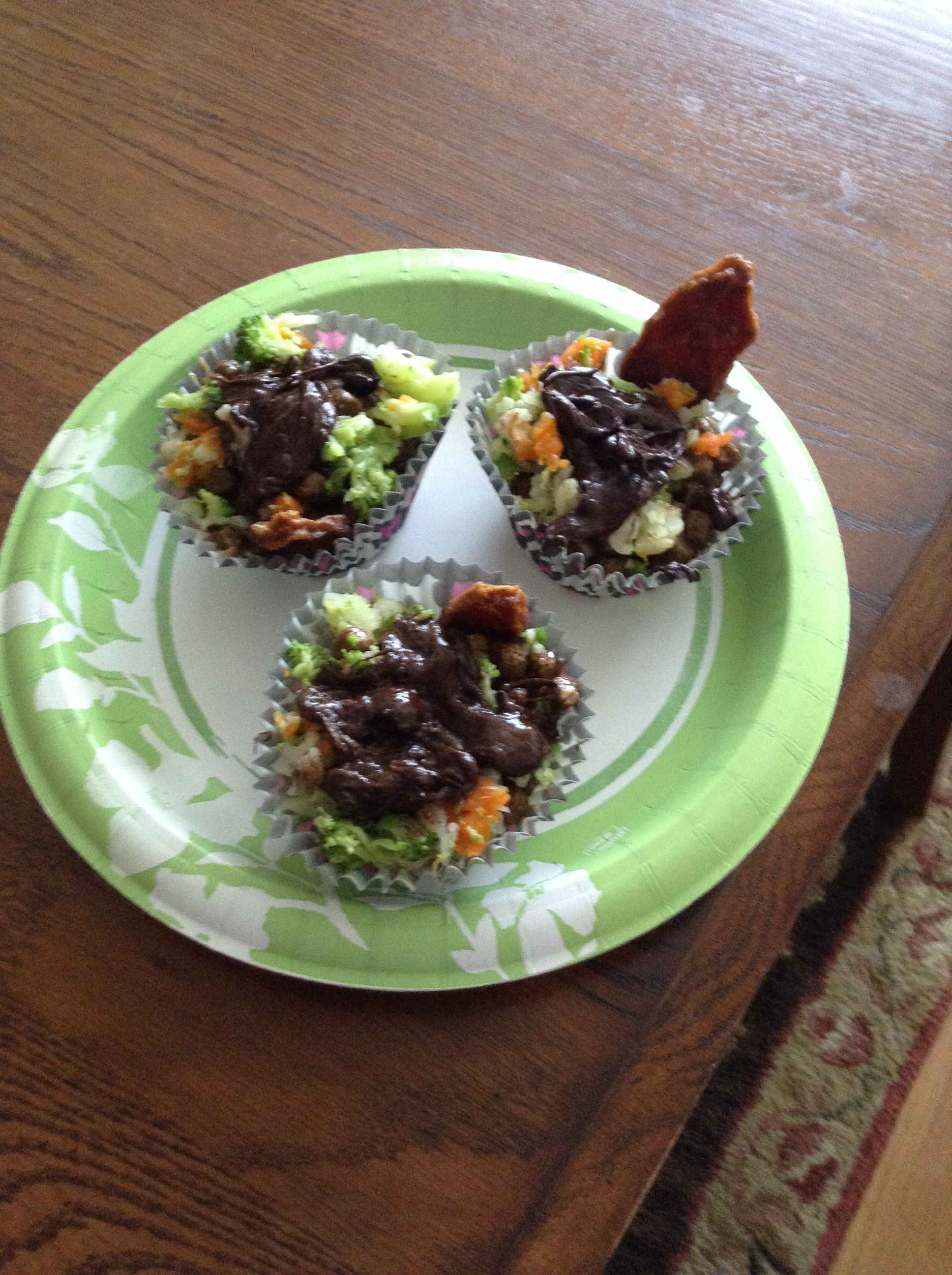 Honey,kibble,peanut butter,veggies,melted carobs, and your dogs fave treat.my dog really loved it.