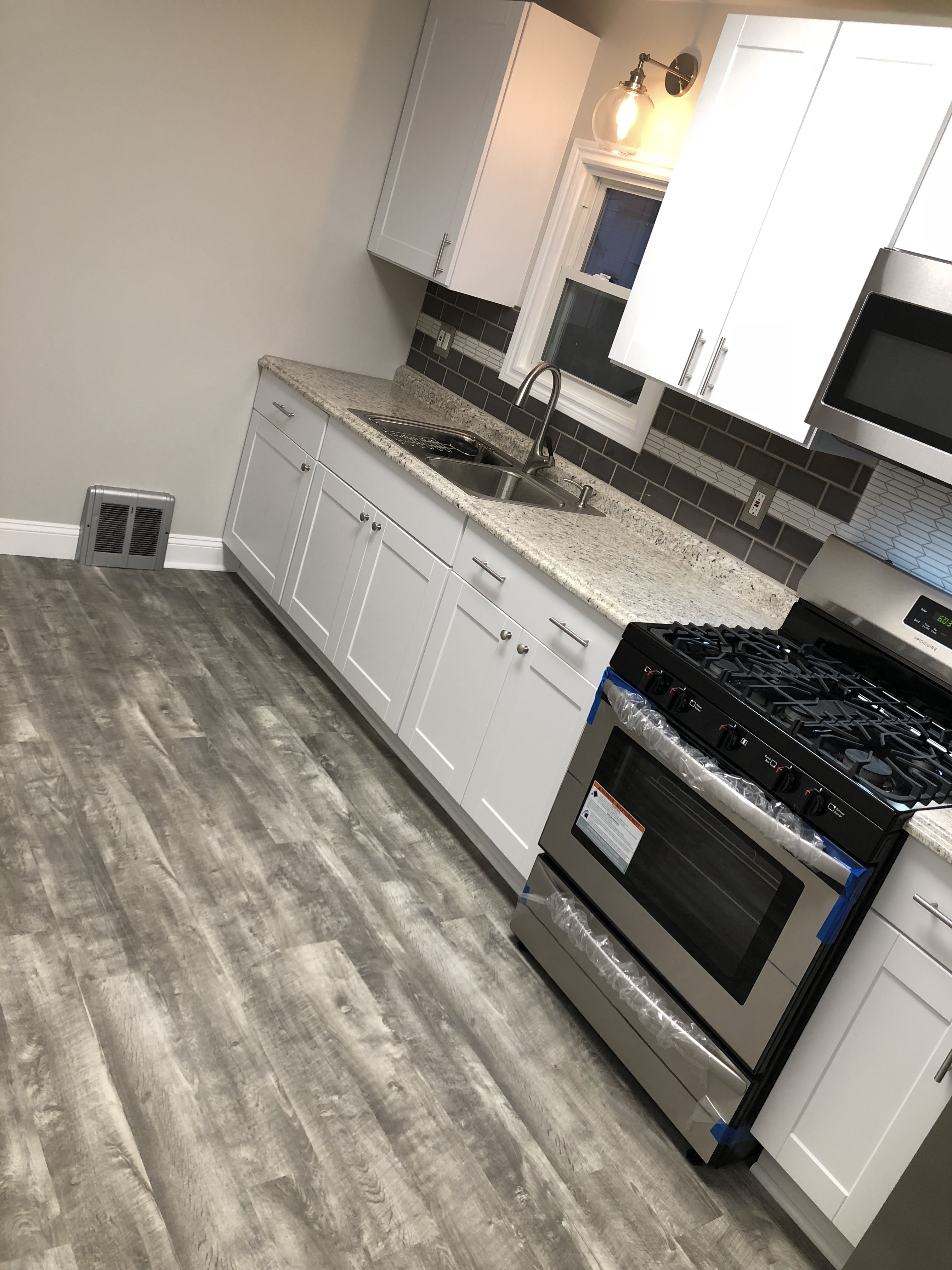 Home decorators Stony oak grey vinyl plank flooring  White shaker     Home decorators Stony oak grey vinyl plank flooring  White shaker kitchen  cabinets