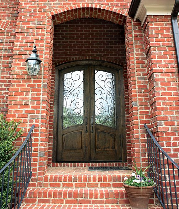 Distressed Finish Aberdeen Redwood Arched Top Door W Flemish Glass Photographed By Cristina