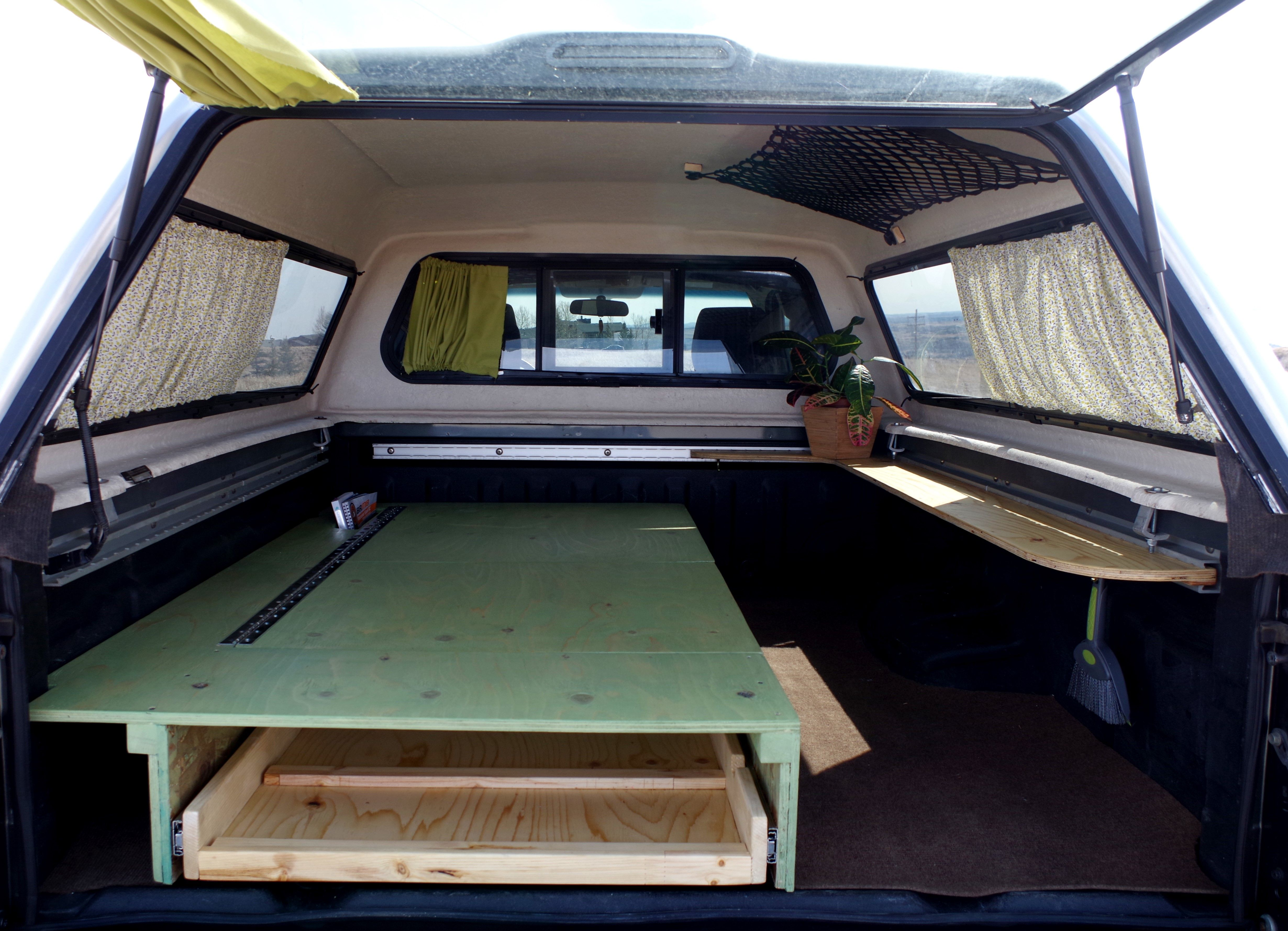 Tiny truck camper mini home in truck bed truck canopy for Diy platform canopy bed