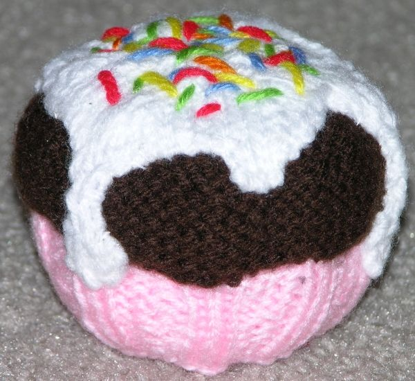 Knitted cupcake with icing and sprinkles, made to look as though it ...