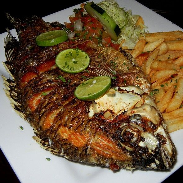 Ugandan Dish Deep Fried Whole Tilapia Yum Ugandan Food Whole Tilapia Recipes Africa Food