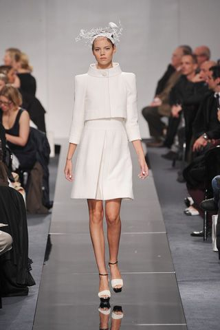 Chanel From a distance, the collection was disciplined into simple planes, the silhouettes cut in an A-line tapering upward to meet cropped jackets with flat, squared-off shoulders and standaway collars.  I have a new with tags 1600 jack from 09p coll for 100 starting bid on http://www.ebay.com/itm/261073282244?ssPageName=STRK:MESELX:IT&_trksid=p3984.m1555.l2649#ht_1580wt_1141