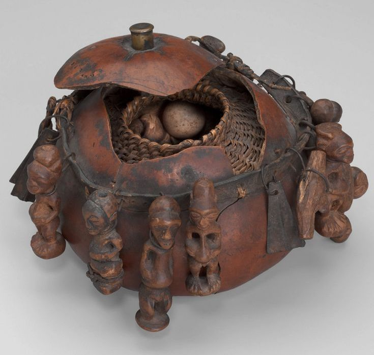 Songye ceremonial vessel (Gourd, wood, iron, shell, bone, eggs, claws, teeth, feathers, bird skull,  leather and fiber) Late 19th to early 20th century