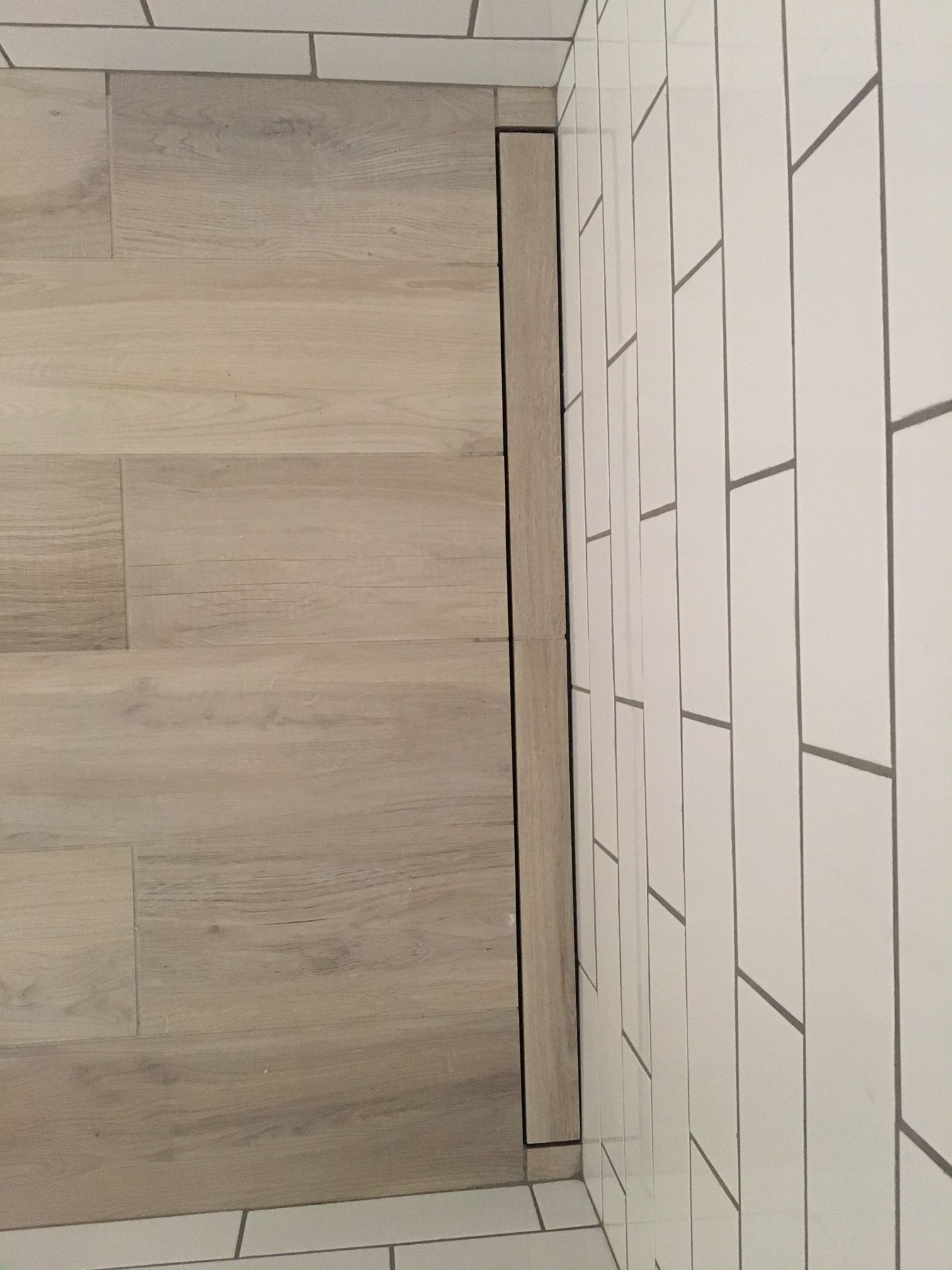 An Interesting Shot Of The Schluter Kerdi Line Drain In The Master Bath Shower Installed With A Beautiful Wood L Master Bath Shower Beautiful Wood Shower Bath