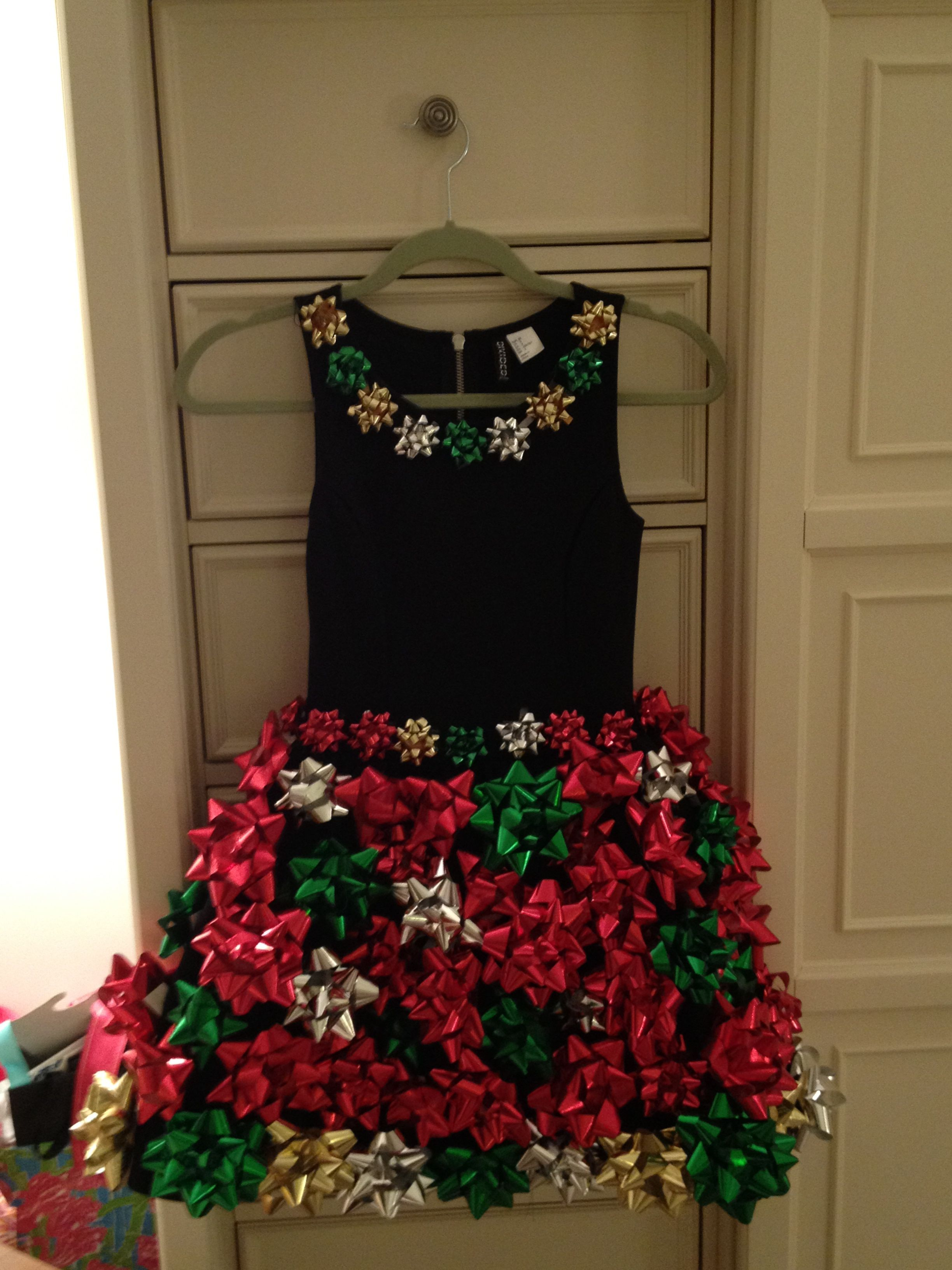 A million bows and 4 days of hand sewing later...Tacky Christmas here I come!