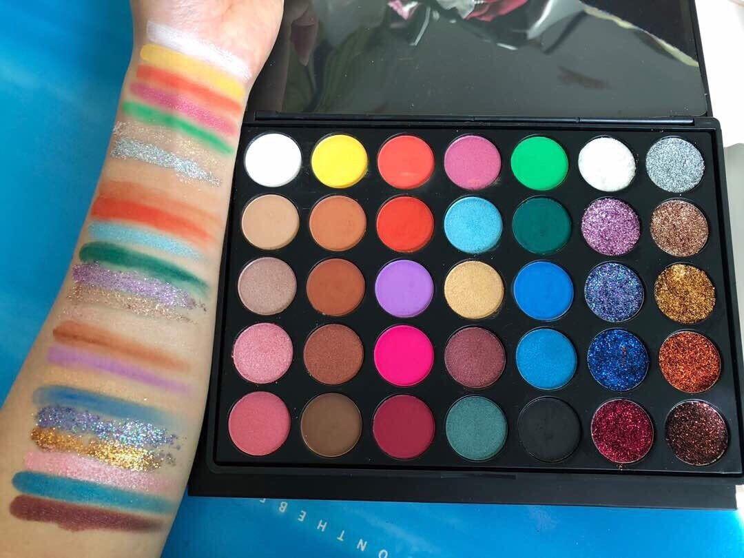 "Miami nights"" eyeshadow palette plus free brush and"
