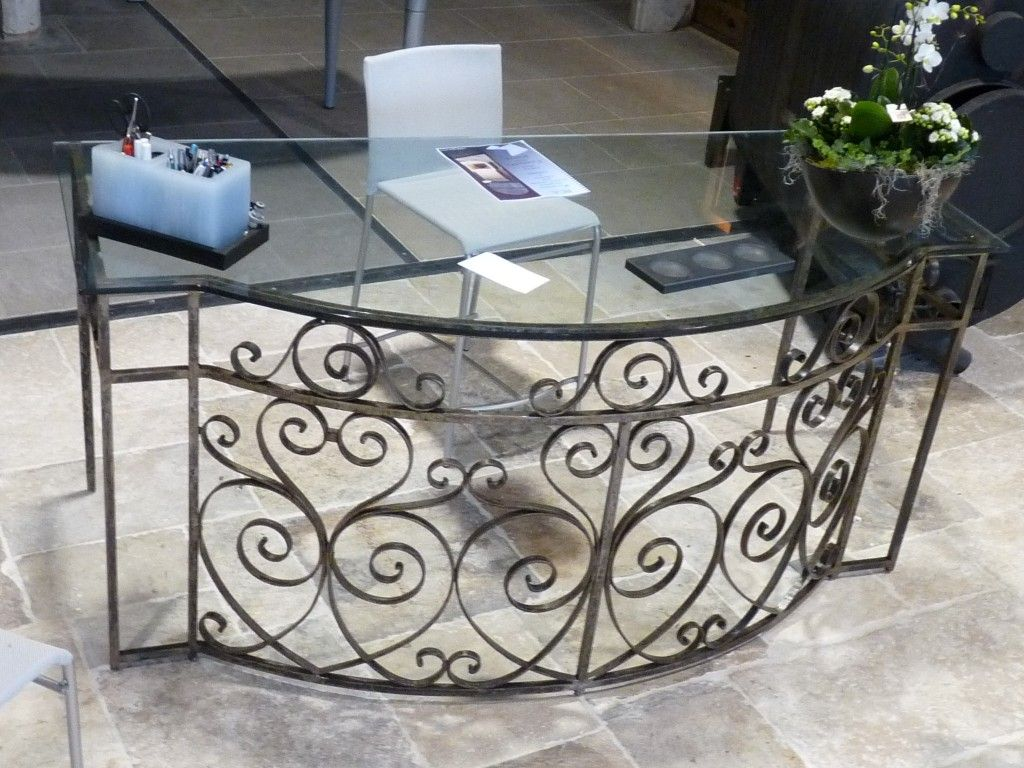 Antique balcony railings converted to glass top desk fer