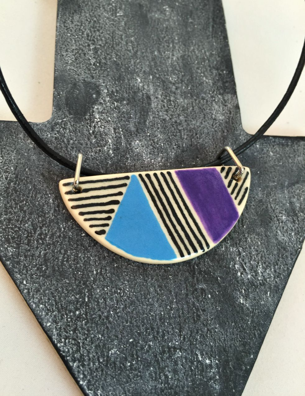 Black purple and blue geometric design on porcelain half